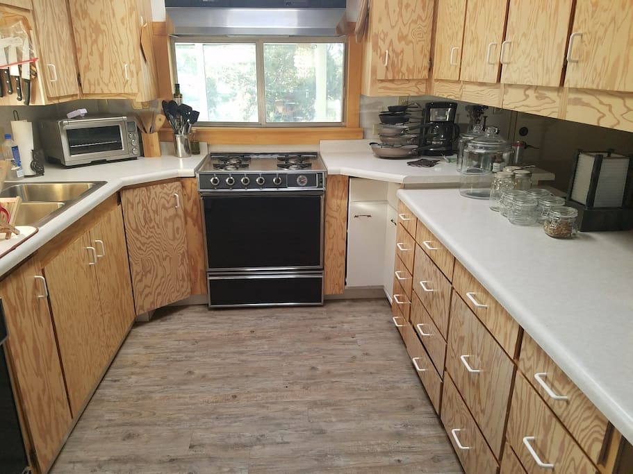 Kitchen with dishwasher, gas stove and toaster oven