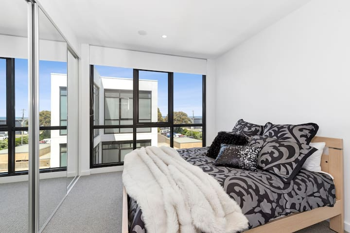 The master bedroom is beautifully appointed with a Queen-size bed and ocean views.