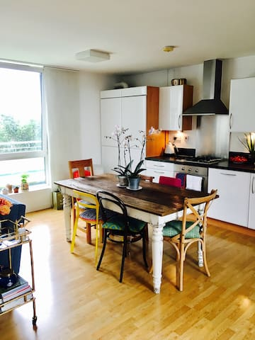 The kitchen area and dining table.  Guests are free to make use of the facilities.