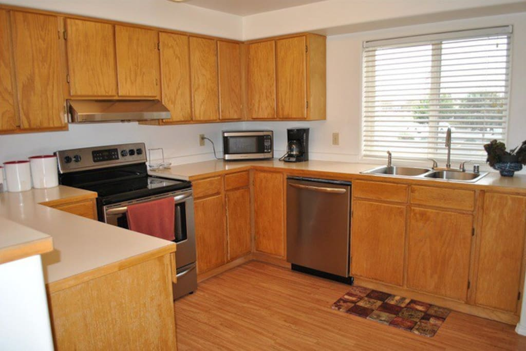 Large kitchen (for a condo) with all new appliances