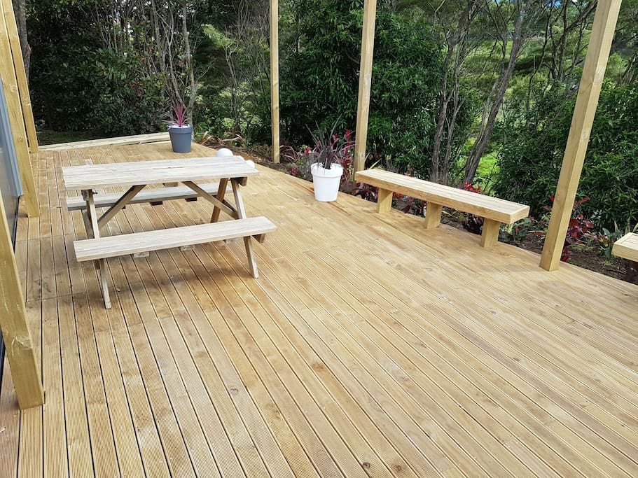 Deck infront of lodge for outdoor eating.