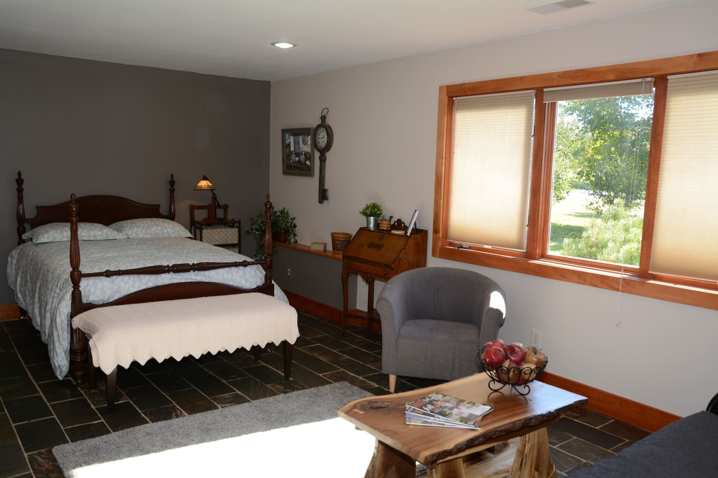 Spacious yet cozy room with large windows.  Full-size bed and futon make plenty of sleeping space available.
