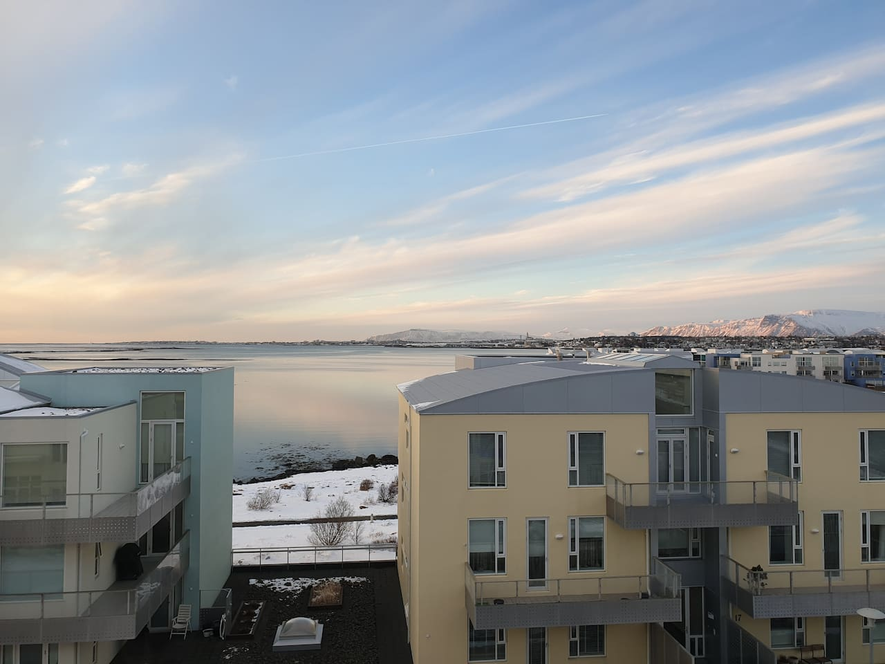 Fantastic panoramic view over the sea, Reykjavik city and the surrounding mountains.