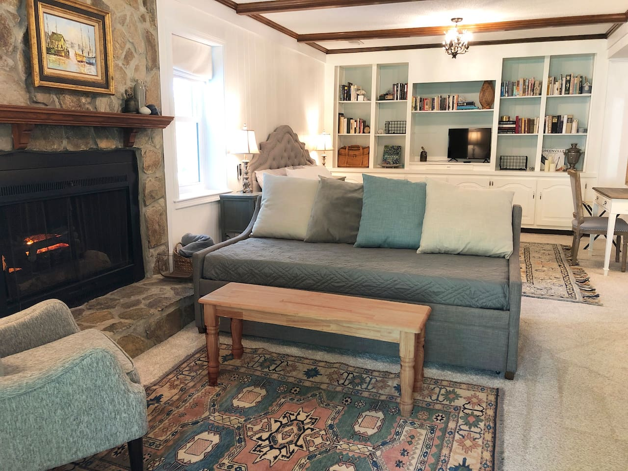 French country inspired guest suite. Ideal for business travelers, romantic couples, or families. Electric log fireplace makes the room feel extra pleasant.