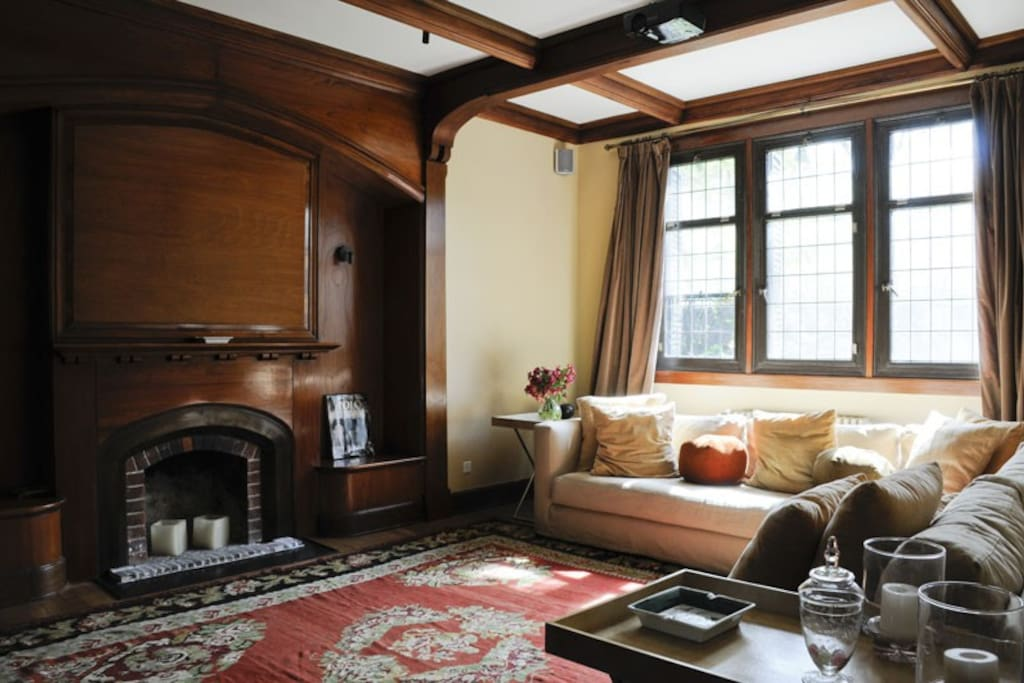 Tv and screening room, comes with a huge sofa, a fire place and an amazing audio equipment