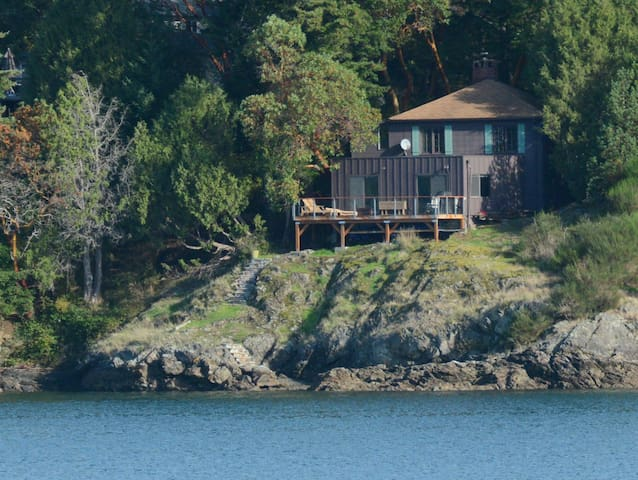 Channelview House sits on a rocky bluff above the water.