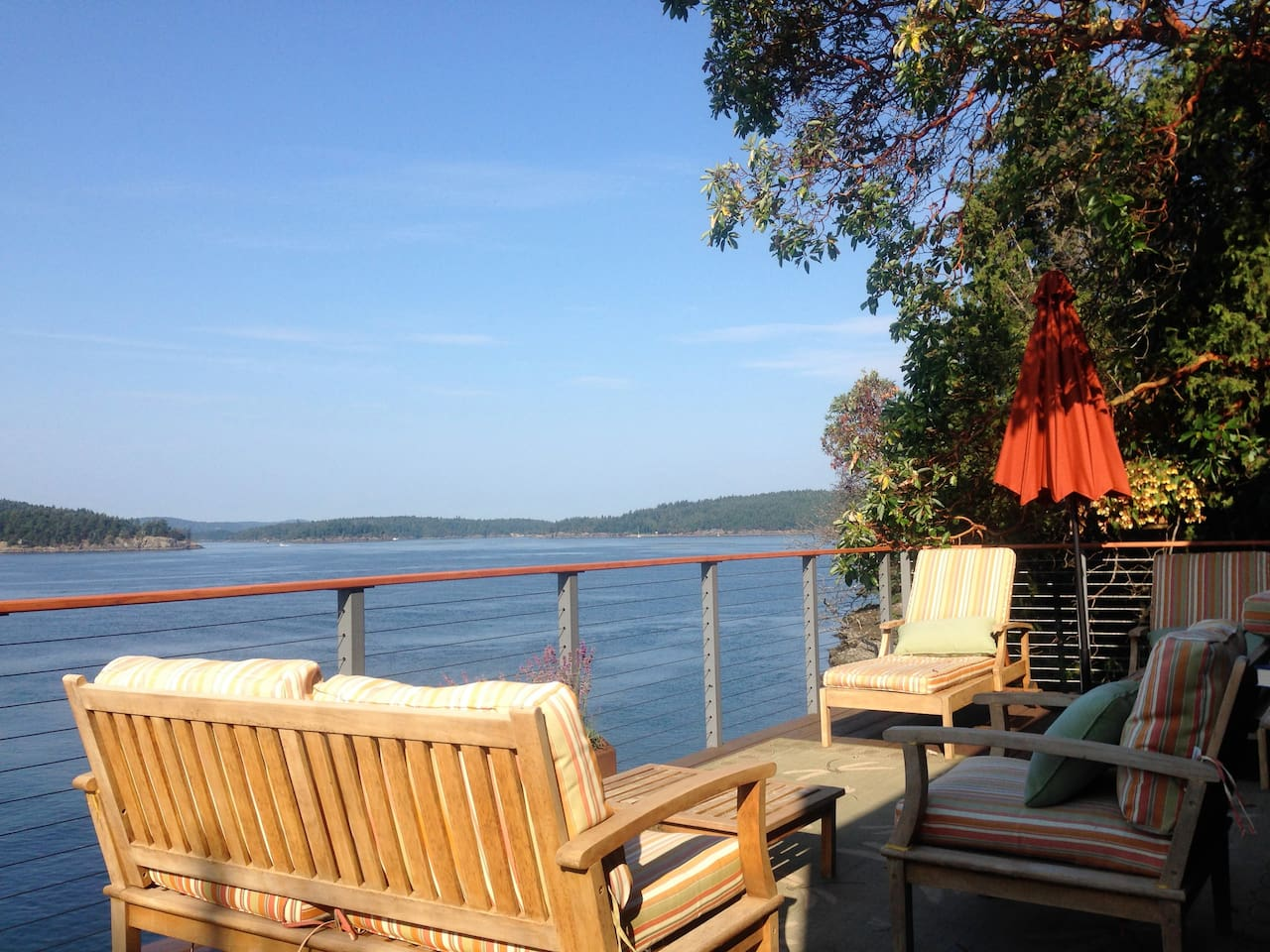 Relax on the beautiful deck which overlooks Harney Channel.