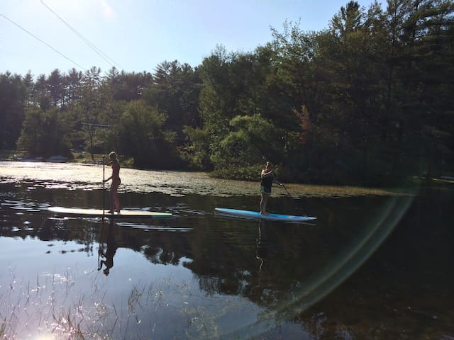 Stand up paddle boarding in creek