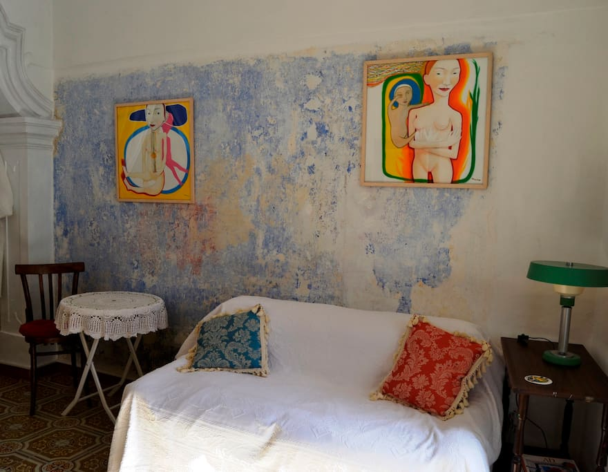 THE CHAPEL BEDROOM: your sofa and wee tables. This is a wall left with the original (ancient) paint on it ....