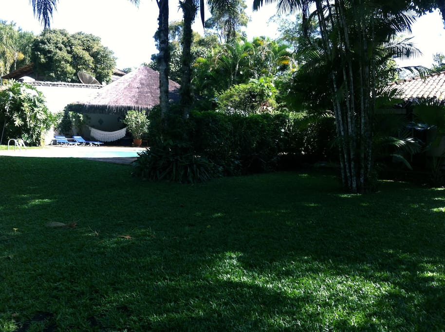 Garden with swimming pool and terrace in the back
