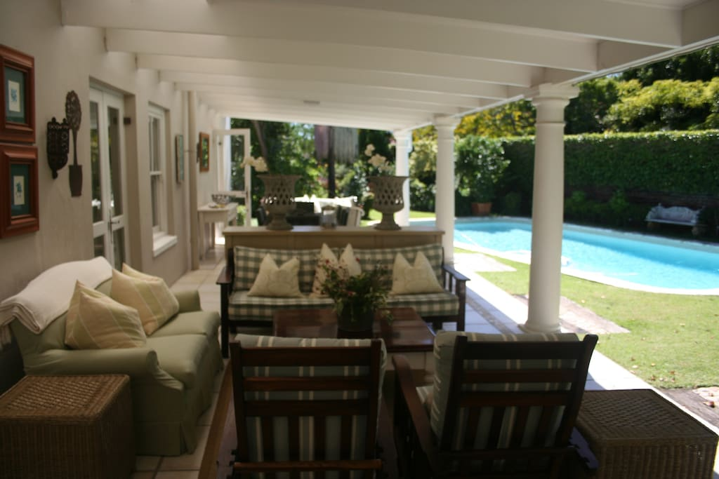 The covered verandah overlooking the large swimming pool.