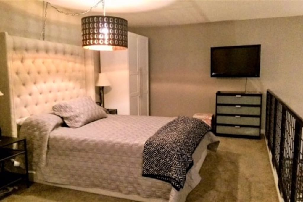 Queen sized bed in the large loft bedroom.