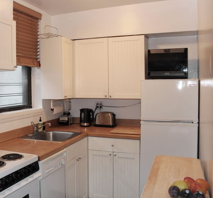 convenient kitchen with all amenities including Nespresso (not shown)