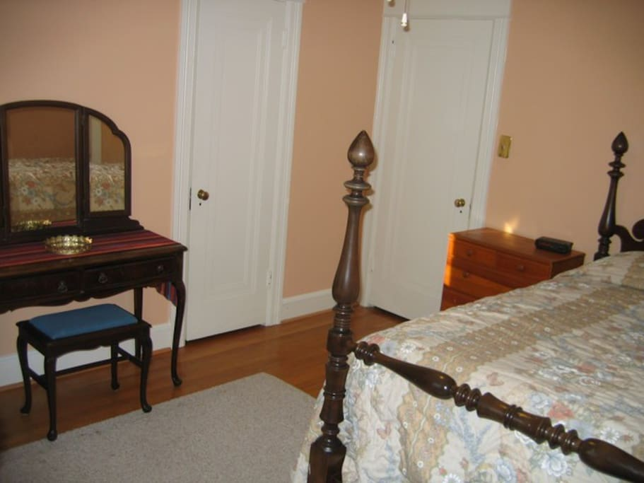 The Peach Room's antique bed and vanity