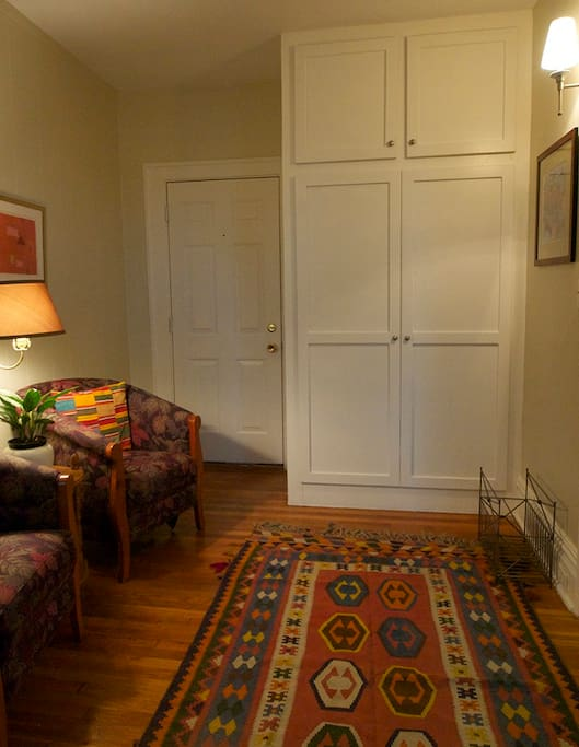 Sitting are with lots of closet space that includes iron and ironing board to make sure you look you best for a night on the town.