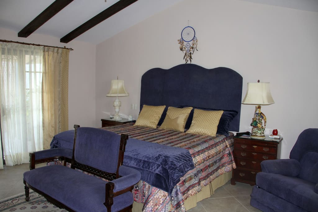 King size upholstered bed with views to lake and private patio on both sides