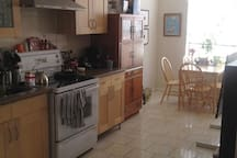 large bright kitchen/dining