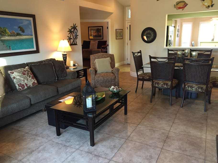 Large family room with comfortable couch and two reclining chairs