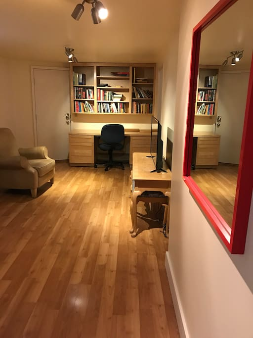 Living room hallway, work desk- lots of games and pretty solid library, if we do say so ourselves
