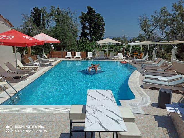 Kalypso Studios  twin room,pool garden (2)