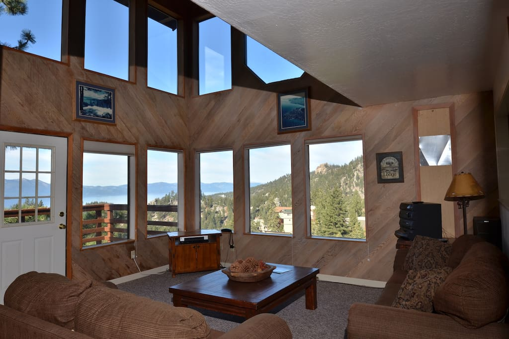Living room w/lake views, Heavenly views, fireplace, cathedral ceiling, and flatscreen TV