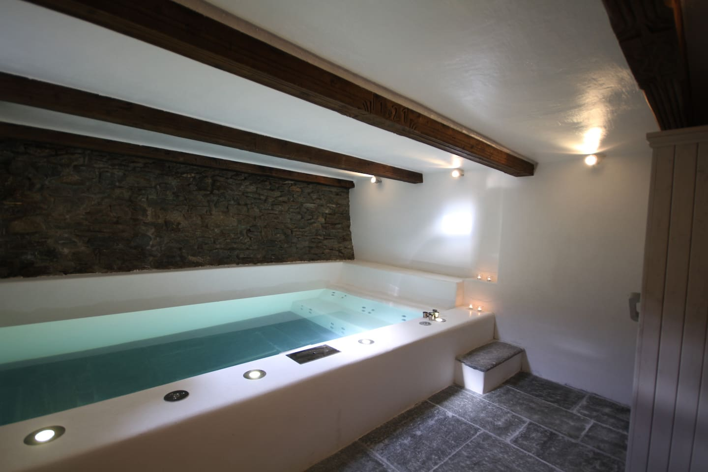 Hot pool with jacuzzi and massage cascade