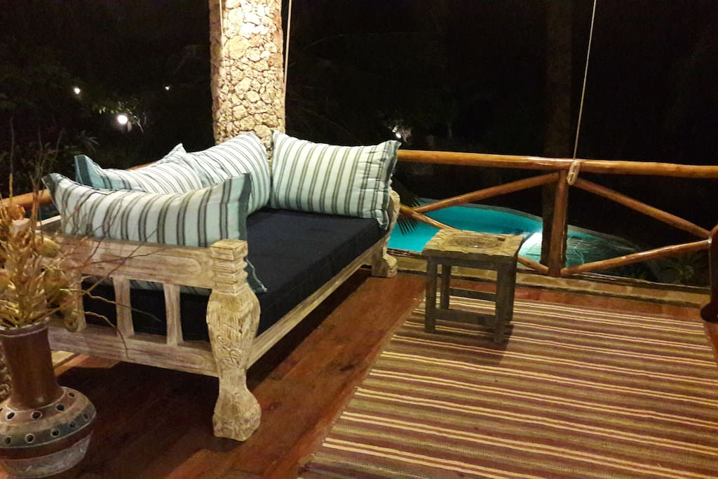 One of the confortable sofas of the living area on the first floor