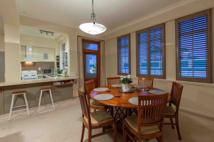 Open plan living with kitchen, dining and balcony