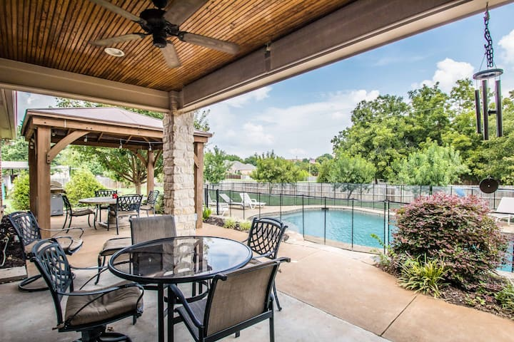 Two covered patios looking over pool