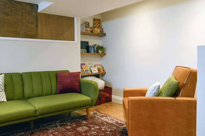 The living room has a small recliner and futon-style sofa that can be used as a bed.  DVDs, games and small toys provided.