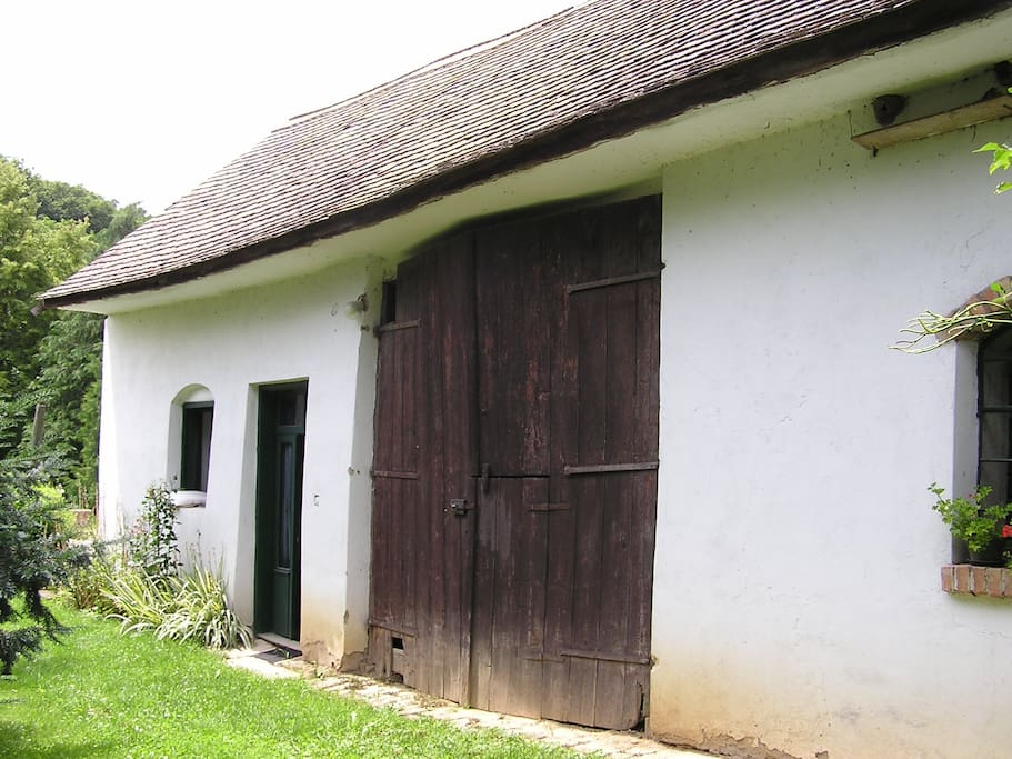 The former stable (now sleeping-room) and hay-shed.