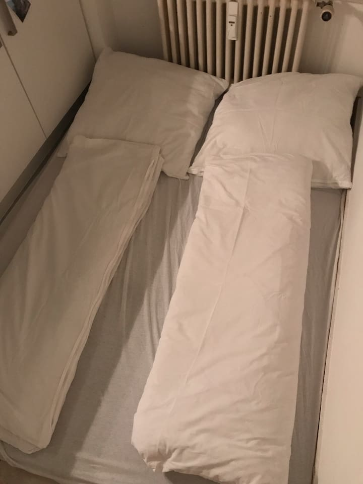 The mattress with sheets and linen