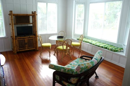 The Garden Room is a large sunny room (25' x25') set on a lush acre with coconut,banana, and fragrant Puakinikini trees,Queen Emma Lilies,ferns and other native plants. It has a private entrance , large picture windows,ensuite, Tea/Coffee,microwave.