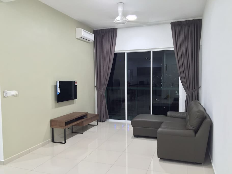 Living Hall with L Shape Sofa, TV and Air-Conditioner