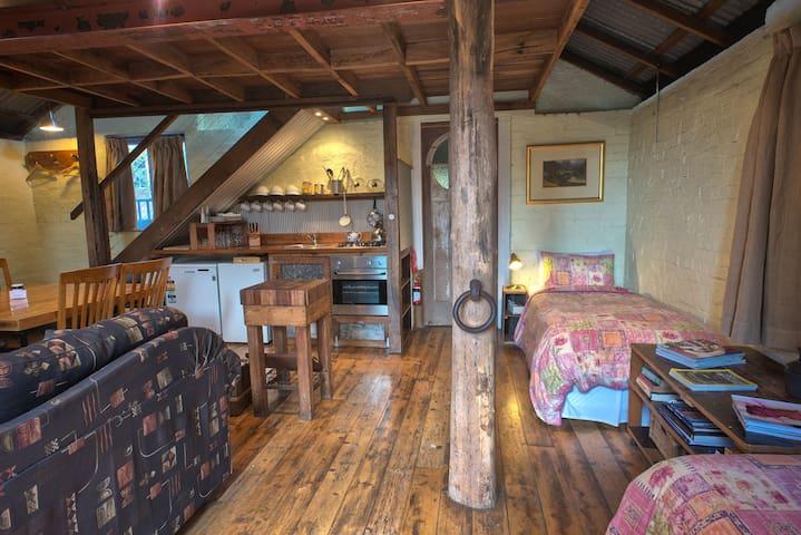 Single beds on open plan main floor