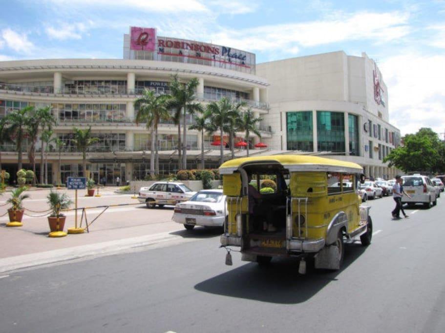 300 meters away - lots of shops, restaurants, grocery (3-5 min walk)