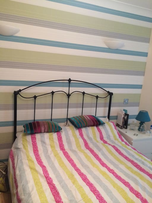 Brightly decorate bedroom. Bedding will change and will even offer a choice. Stripes or spots. Just joking