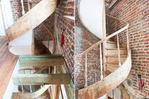 The staircase that leads to the private part of the house.