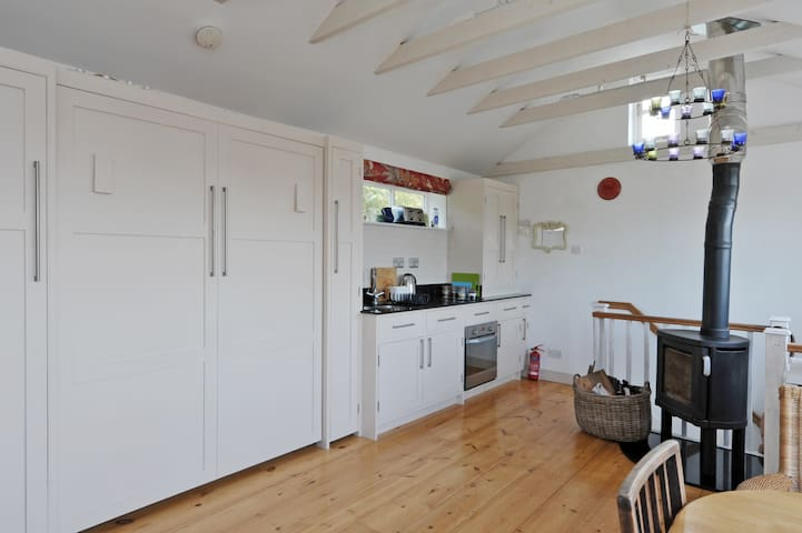 Kitchen area with double bed folded away