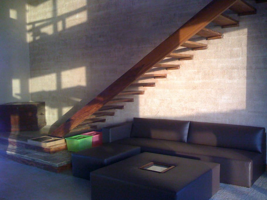 wooden stairs leading to the the first floor..