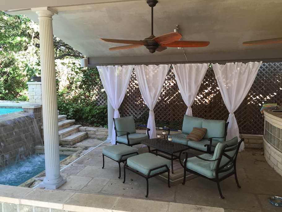Covered patio with fans by the pool.