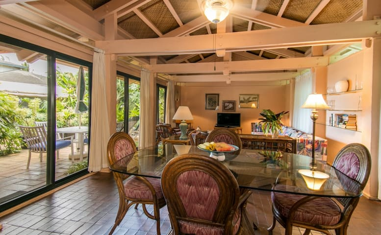 Living and Dining with sliding glass doors on both sides.