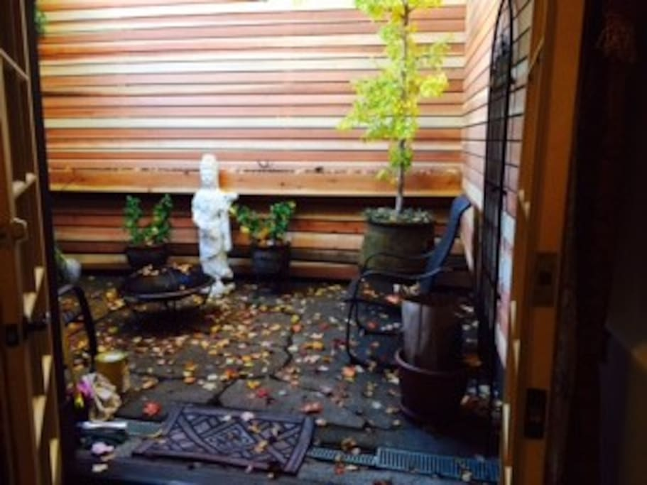 Patio with 2 chairs, swing and fire pit,