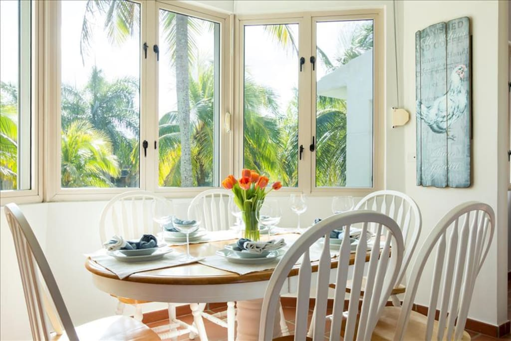 The dining room overlooks palm trees, fountains, a