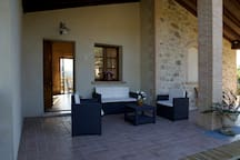 big portico-lounge area in front of the apartment