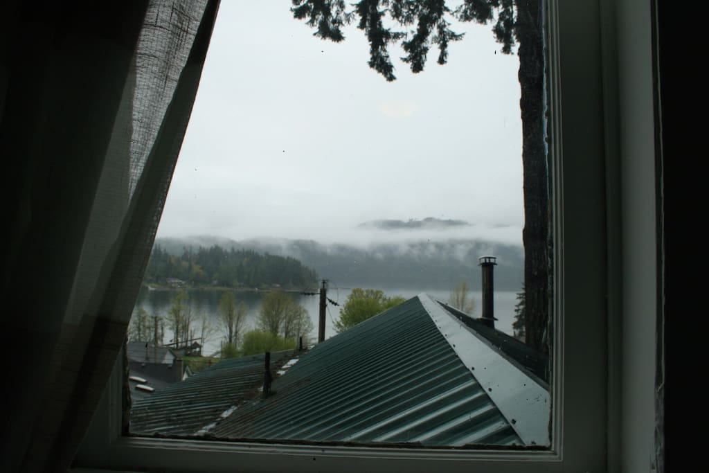 Bedroom has many windows. This one looks out toward the lake view.