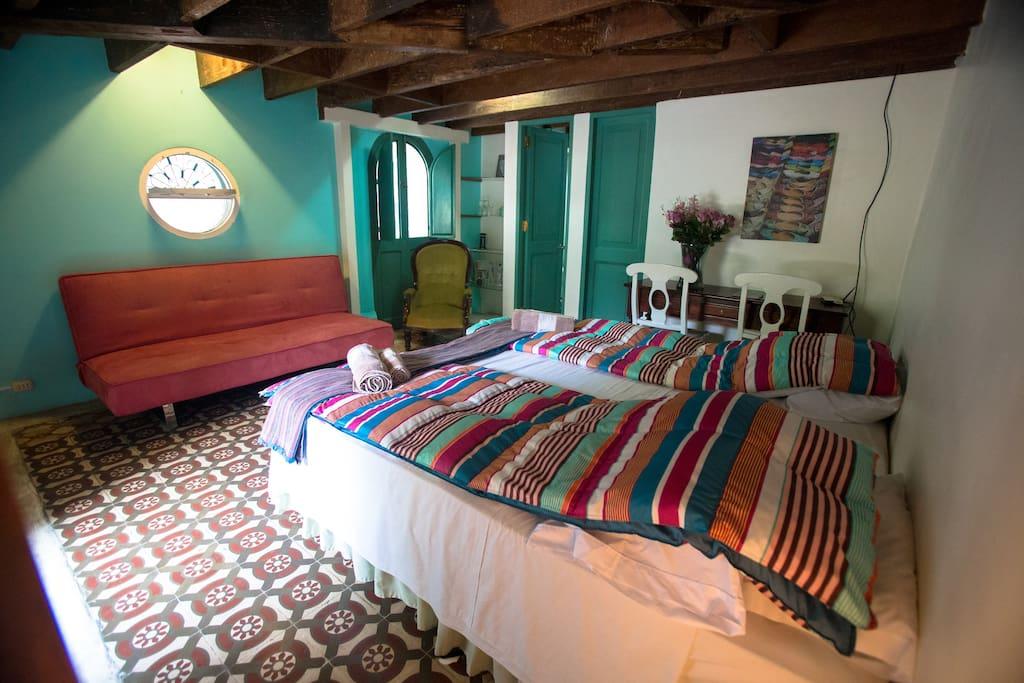 Bedroom overview, nice details as original circular window