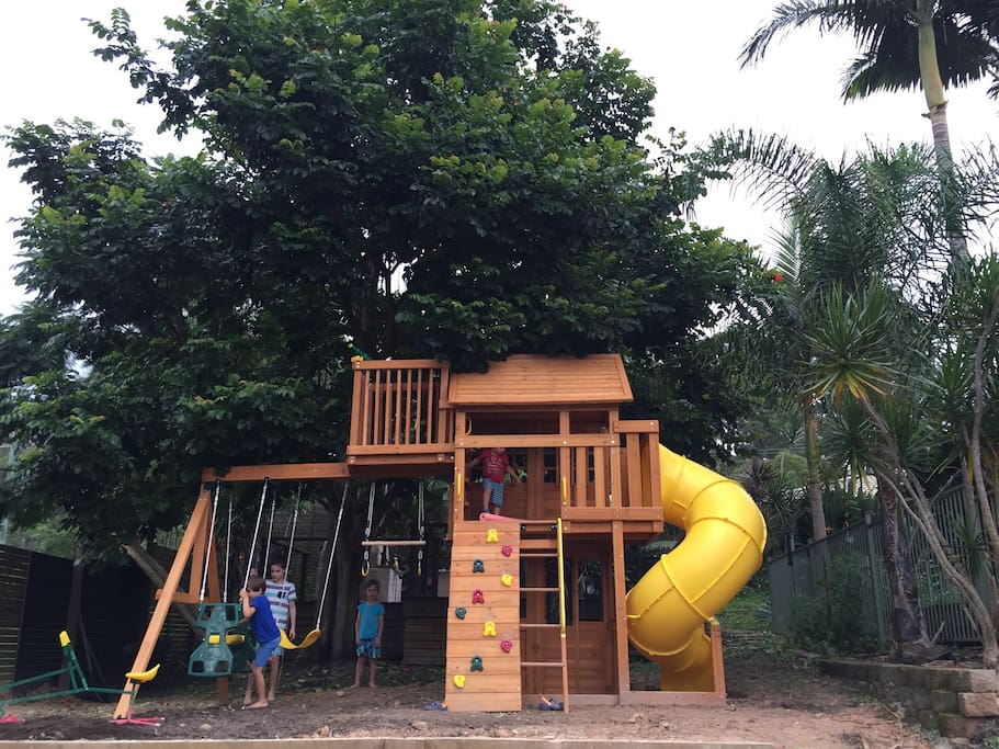 Brand new Children's playground in our backyard! Complete with swing, monkey bars, glider, telescope, cafe, blackboard, climbing wall, curvy fast slide and cubby house in the trees!