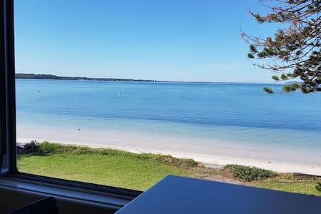 Sunrise Beachfront Apartment - on the waters edge!