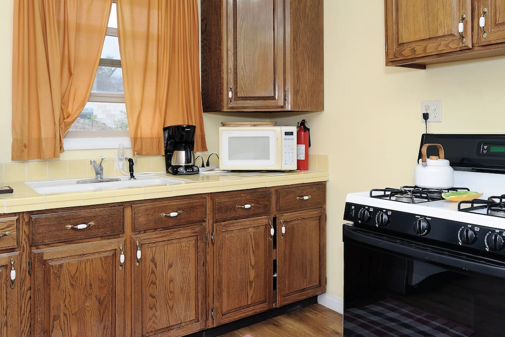 kitchen with gas stove and microwave.